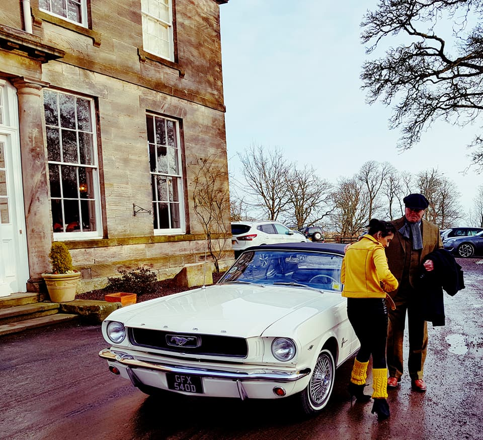 Arusha 'Roo' Irvine & James Braxton with their 1969 Mustang